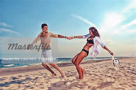 young boy and girl running on beach Stock Photo - Budget Royalty-Free, Image code: 400-05880290