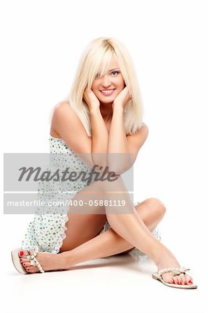 Young blond woman sitting on a floor Stock Photo - Budget Royalty-Free, Image code: 400-05881119