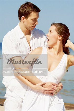 Amazed young couple on a beach Stock Photo - Budget Royalty-Free, Image code: 400-05881203
