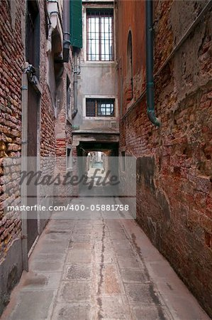 Narrow street in Venice, Italy, ending at a getty in a canal Stock Photo - Budget Royalty-Free, Image code: 400-05881758