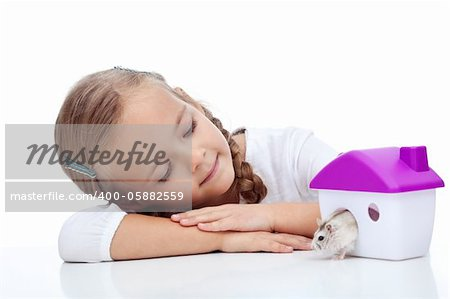 Little girl watching her hamster crawling out of plastic house Stock Photo - Budget Royalty-Free, Image code: 400-05882559