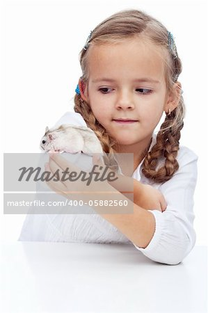 Wait you little devil - little girl catching her runaway hamster Stock Photo - Budget Royalty-Free, Image code: 400-05882560