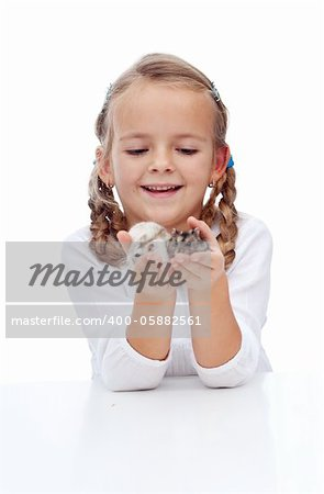 My little lovely buddies - girl and her hamsters Stock Photo - Budget Royalty-Free, Image code: 400-05882561