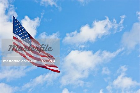 American flag on a blue sky during a windy day Stock Photo - Budget Royalty-Free, Image code: 400-05902840