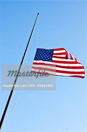 American flag on a blue sky during a windy day Stock Photo - Budget Royalty-Free, Image code: 400-05902841