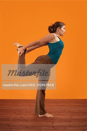 Woman practising yoga stretches her leg backwards Stock Photo - Budget Royalty-Free, Image code: 400-05907908