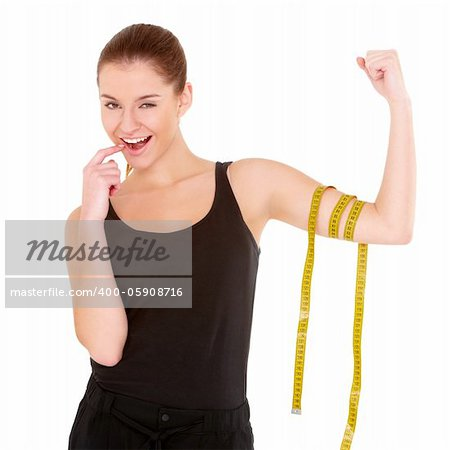 Fitness woman with measure tape on white background Stock Photo - Budget Royalty-Free, Image code: 400-05908716