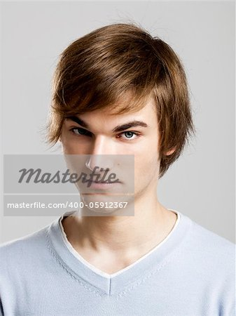 Portrait of a handsome young man over a gray background Stock Photo - Budget Royalty-Free, Image code: 400-05912367
