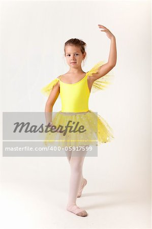 Cute little girl as ballet dancer, studio shot on white background Stock Photo - Budget Royalty-Free, Image code: 400-05917599