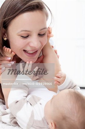 Happy mother playing with her baby - closeup Stock Photo - Budget Royalty-Free, Image code: 400-05919466