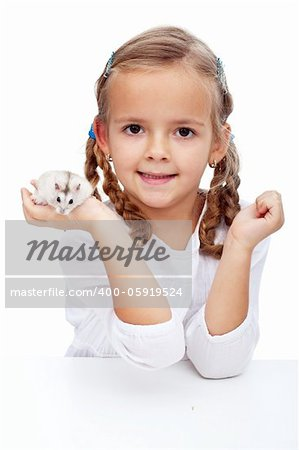 Here is my hamster - little girl with her pet Stock Photo - Budget Royalty-Free, Image code: 400-05919524