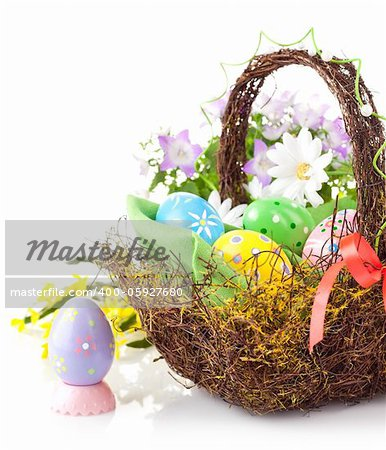 easter egg in basket with spring flower isolated on white background Stock Photo - Budget Royalty-Free, Image code: 400-05927680