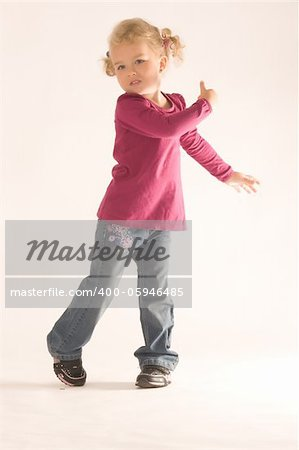 Little blonde girl with curly hair has fun at the dance Stock Photo - Budget Royalty-Free, Image code: 400-05946485