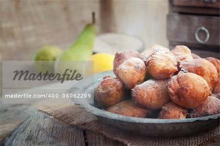 Bowl of Deep fried fritters donuts in rustic country setting Stock Photo - Budget Royalty-Free, Image code: 400-06062209