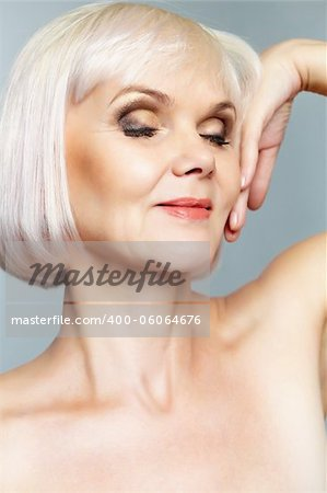 Portrait of a nude mature lady with her eyes closed and hand gracefully held Stock Photo - Budget Royalty-Free, Image code: 400-06064676