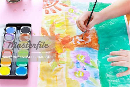 Detail of hands painting with watercolor Stock Photo - Budget Royalty-Free, Image code: 400-06068460