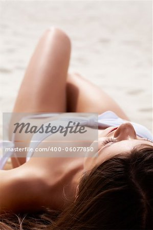 Image of female in white bikini sunbathing on sandy beach during vacation Stock Photo - Budget Royalty-Free, Image code: 400-06077850
