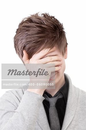 A young man in a gray cardigan shows facepalm Stock Photo - Budget Royalty-Free, Image code: 400-06080055