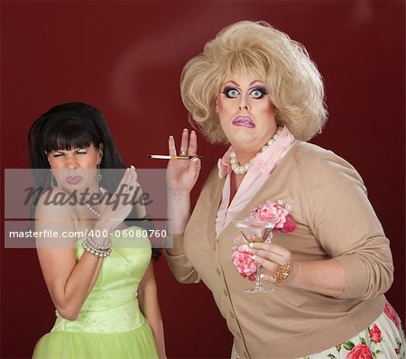 Disgusted woman reacts to drag queen smoking cigarette Stock Photo - Budget Royalty-Free, Image code: 400-06080760
