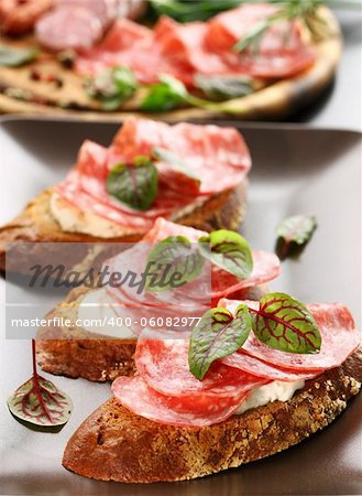 Canape with cream cheese, salami and herbs Stock Photo - Budget Royalty-Free, Image code: 400-06082977
