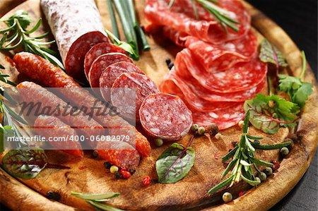 Different Italian ham and salami with herbs Stock Photo - Budget Royalty-Free, Image code: 400-06082979