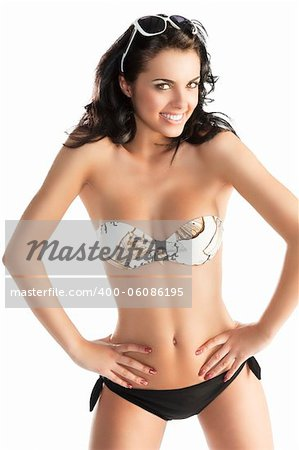 very beautiful sensual woman with long black hair sunglasses and stone necklace in fashion swimsuit, she is in front of the camera with both hands on the hips, she looks in to the lens and smiles Stock Photo - Budget Royalty-Free, Image code: 400-06086195