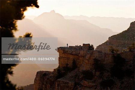 Image of a lone person looking out over an early mornig view of the Grand Canyon Stock Photo - Budget Royalty-Free, Image code: 400-06094774