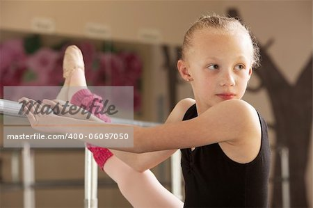 Serious child ballet student looks over her shoulder Stock Photo - Budget Royalty-Free, Image code: 400-06097050