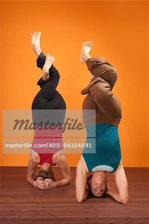 Two fit women in upside down position with interweaved legs Stock Photo - Budget Royalty-Free, Image code: 400-06104091