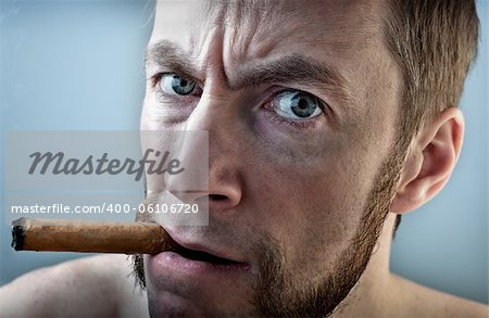 a man with a cigar, looking into the camera Stock Photo - Budget Royalty-Free, Image code: 400-06106720