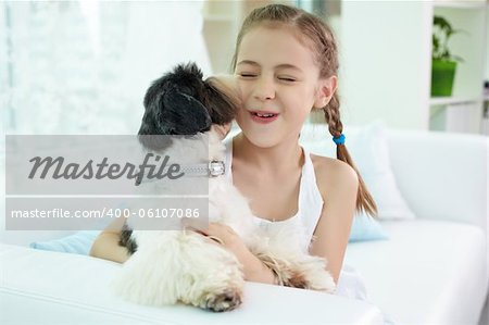 Portrait of happy girl playing with shih-tzu dog at home Stock Photo - Budget Royalty-Free, Image code: 400-06107086