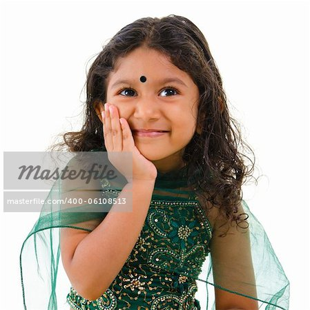 Thoughtful little Indian girl hand on chin , isolated white background Stock Photo - Budget Royalty-Free, Image code: 400-06108513