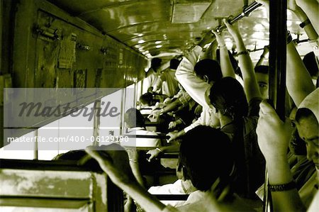 A crowded Delhi Transport Corporation Bus in New Delhi, India. The DTC buses, which run on Compressed Natural Gas are the back bone of Delhi. Stock Photo - Budget Royalty-Free, Image code: 400-06129190
