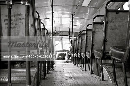 An empty Delhi Transportation Bus as it gears up for a busy day on the streets of New Delhi, India. The DTC buses are the back bone of the city. Stock Photo - Budget Royalty-Free, Image code: 400-06129191