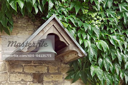 Bell of an old monastery and the wall covered with ivy Stock Photo - Budget Royalty-Free, Image code: 400-06135773