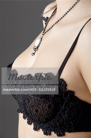 Young adult caucasian woman wearing black lace lingerie on a neutral grey background. Stock Photo - Budget Royalty-Free, Image code: 400-06135910