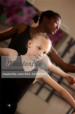 Two young ballet students concentrate in class Stock Photo - Budget Royalty-Free, Image code: 400-06138340