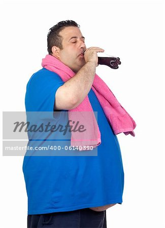 Fat man in the gym drinking cola isolated on a white background Stock Photo - Budget Royalty-Free, Image code: 400-06140390