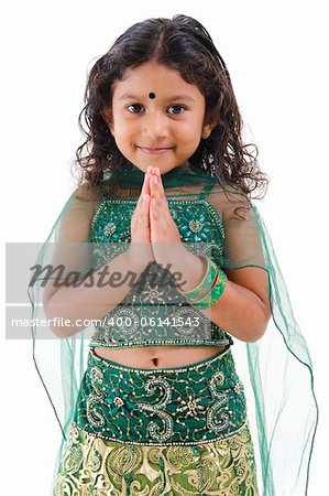 Cute little Indian girl in a greeting pose, isolated white background Stock Photo - Budget Royalty-Free, Image code: 400-06141543