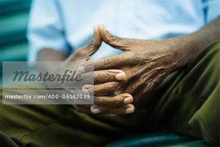 closeup of hands of elderly african american man sitting on bench Stock Photo - Budget Royalty-Free, Image code: 400-06142039