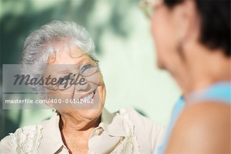 Active retirement, two elderly female friends talking on bench in public park Stock Photo - Budget Royalty-Free, Image code: 400-06142462