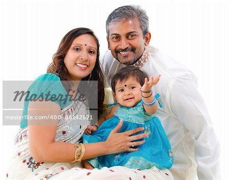 Traditional Indian family with one child sitting on white background Stock Photo - Budget Royalty-Free, Image code: 400-06142521