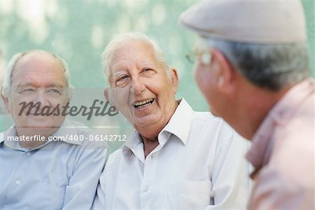 Active retirement, group of three old male friends talking and laughing on bench in public park Stock Photo - Budget Royalty-Free, Image code: 400-06142712