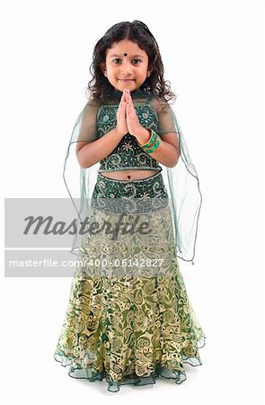 Cute little Indian girl in a greeting pose, isolated white background Stock Photo - Budget Royalty-Free, Image code: 400-06142827
