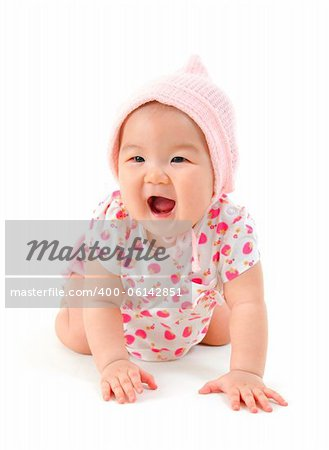Six months old Asian mixed race baby girl crawling over white background.