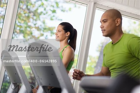 Man and woman working out and running on treadmill in fitness club Stock Photo - Budget Royalty-Free, Image code: 400-06142895
