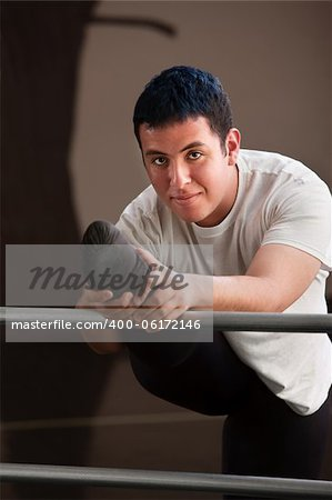 Smiling young male dancer stretching for practice Stock Photo - Budget Royalty-Free, Image code: 400-06172146