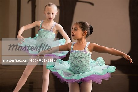 Two adorable children twirling during ballet practice Stock Photo - Budget Royalty-Free, Image code: 400-06172147