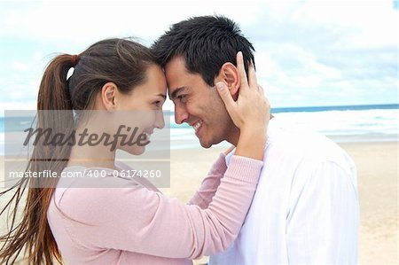 romance on vacation: couple in love on the beach flirting Stock Photo - Budget Royalty-Free, Image code: 400-06174260