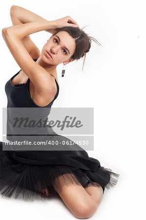 female ballet dancer in black dress holding her hair isolated on white Stock Photo - Budget Royalty-Free, Image code: 400-06174530